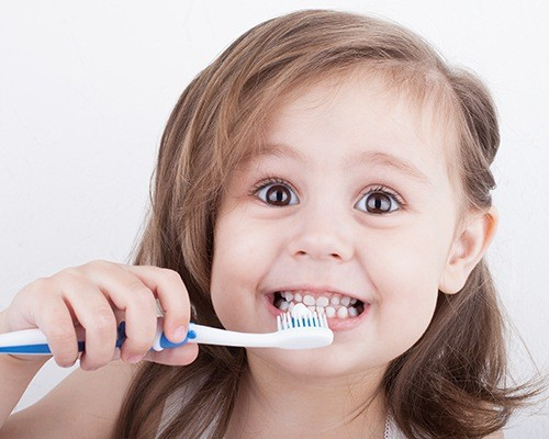 Child brushing her teeth