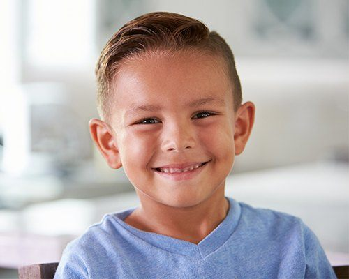 Young boy with healthy smile