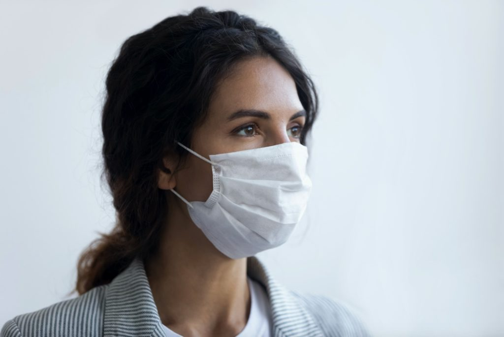 Woman wearing face mask at dentist in Center