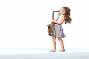 little girl playing a saxophone