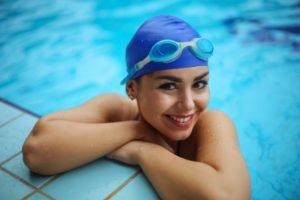Woman in pool enjoying the summer sun