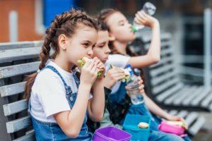 Schoolchildren eating lunches recommended by Center children's dentist